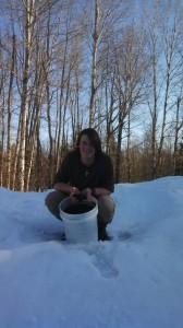 Joe Baker and a bucket of Baker's Biochar