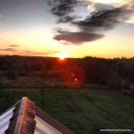 A summer sunset from the barn roof.
