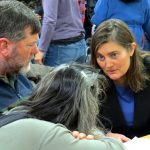 Huddle time: Mark, Michelle Halley, and Jill consulting after the verdict.